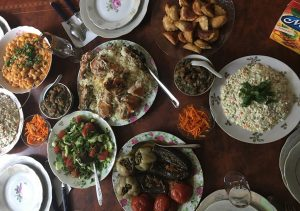 Table of Azerbaijani food, dolma, salad