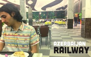 Man with cake in Azerbaijan Railway station in Baku