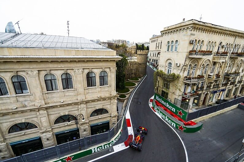 A race car between two buildings in Baku